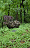 Garden Stone Sphere. Drystone sphere in a woodland setting Stock Photo