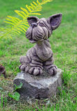 Garden stone statue of dog on the lawn Royalty Free Stock Photos