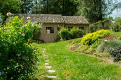 Garden Storage Shed. A garden storage shed in a well manicured garden Royalty Free Stock Image