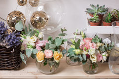 Garden store. glass vase with Mixed bouquet on wood table. beautiful fresh flowers still life. Stock Image