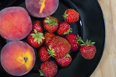 Garden Strawberries and peaches Royalty Free Stock Image