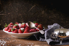 Garden strawberries with sugar and cream Stock Photography