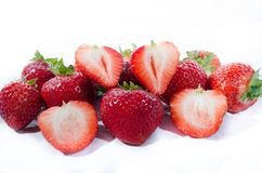 Super sweet strawberry;s with green tops with two showing off royalty free stock image