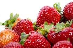 Lots of red super sweet strawberry;s with green tops stock photos