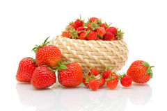 Garden strawberry and wild strawberry on a white Royalty Free Stock Image