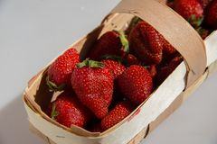 Garden strawberry in wooden basket Stock Photography
