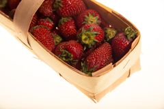 Garden strawberry in wooden basket Royalty Free Stock Images