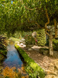 Garden Stream. This is a small section of a village stream which runs along the front of a number of old houses. It runs alongside the road, and each house is Royalty Free Stock Photography