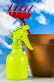 Garden stuff on bright blue background Stock Images
