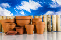 Garden stuff on bright blue background Royalty Free Stock Images