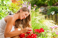 Garden in summer – happy woman with flowers Stock Image