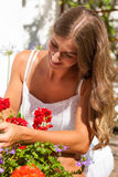 Garden in summer - happy woman with flowers Stock Photos