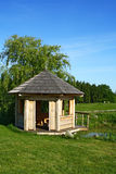 Garden summer-house. At a pond Royalty Free Stock Image