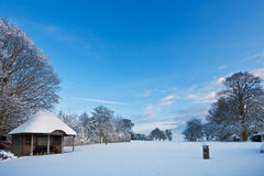Garden with summerhouse covered in fresh snow Stock Photo