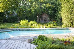 Garden and swimming pool in backyard stock image