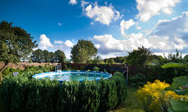 Garden and swimming pool Royalty Free Stock Photos