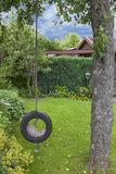 Garden swing. Playground with a self made garden swing hanging on a tree Stock Photos