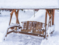Garden Swing covered in Snow Stock Images