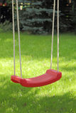 Garden swing hanging on tree. Royalty Free Stock Photography