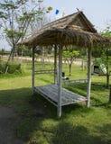 Garden swing rest chair grass hot sunshine entry concept Stock Photos