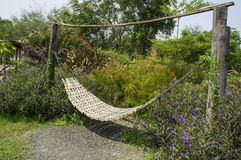 Garden swing rest chair grass hot sunshine entry concept Royalty Free Stock Photos