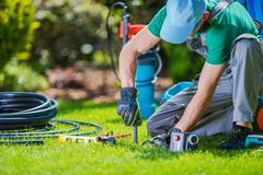 Garden Systems Installer. Garden Automatic Watering Systems Installer. Garden System Technician at Work Royalty Free Stock Images