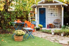 Free Garden Table And Chairs With Apples And Pumpkins On Autumn Yard. Terrace With Retro Light Bulbs Garlands. Beautiful Porch Home Wit Royalty Free Stock Images - 199243899