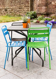 Garden table and chair on patio. Metal garden furniture of table and chairs on a patio or street restaurant Royalty Free Stock Images
