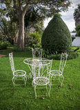 Garden table and chairs. In a backyard Stock Photos