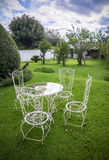 Garden table and chairs. In a backyard Stock Images