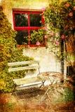 Garden table and chairs. Avoca. Ireland. Cozy corner. garden table, chairs and bench sourrounded by flowers and ivy. Avoca. Ireland Royalty Free Stock Image