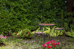 Garden with table chairs set Royalty Free Stock Photography