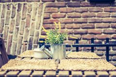 Garden table in the city. With watering can stock photos