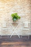 A garden table near the house. With a big, bouquet of flowers. royalty free stock photos