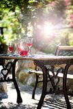 Garden table red wine. Drinks on table in garden wine red garden table and bench stock photos