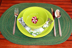 Garden table set for lunch. On a summer day Royalty Free Stock Photo