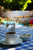Garden table with turkish coffee and water. Garden table with turkish coffee and water in the summer Stock Image