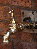 Garden tap. On a brick wall royalty free stock photo