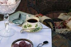 Garden Tea Party. Retro Style.Rustic Style.Vintage tea Cup. Garden Tea Party. Vintage Tea Cup with Lilies of the Valley. English Tea in Garden. Retro Style Stock Photo