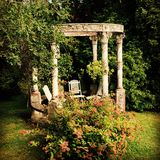 Garden temple. A quiet and relaxed space in the garden for mediation Royalty Free Stock Photos