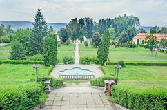 The garden, terrace of Palace Brukenthal Avrig, trees and founta Royalty Free Stock Images