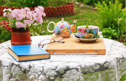 In the garden there is a table for morning tea and outdoor recreation stock image