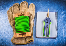 Garden tie wire secateurs leather protective gloves workbook on Royalty Free Stock Image