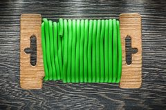 Garden tie wire on wooden board Royalty Free Stock Photo