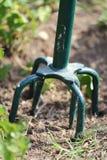 Garden Tiller. Close up view of a garden tiller tilling up the land Stock Photo