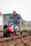 Garden tiller to work royalty free stock image