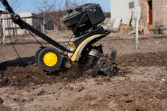 Garden tiller to work Royalty Free Stock Images