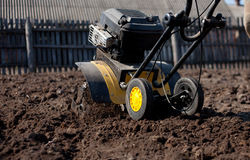 Garden tiller to work Stock Images