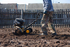 Garden tiller to work. The Garden tiller to work, walk-behind tractor Royalty Free Stock Image