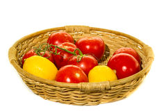 Garden tomatoes basket. On white background Stock Photography